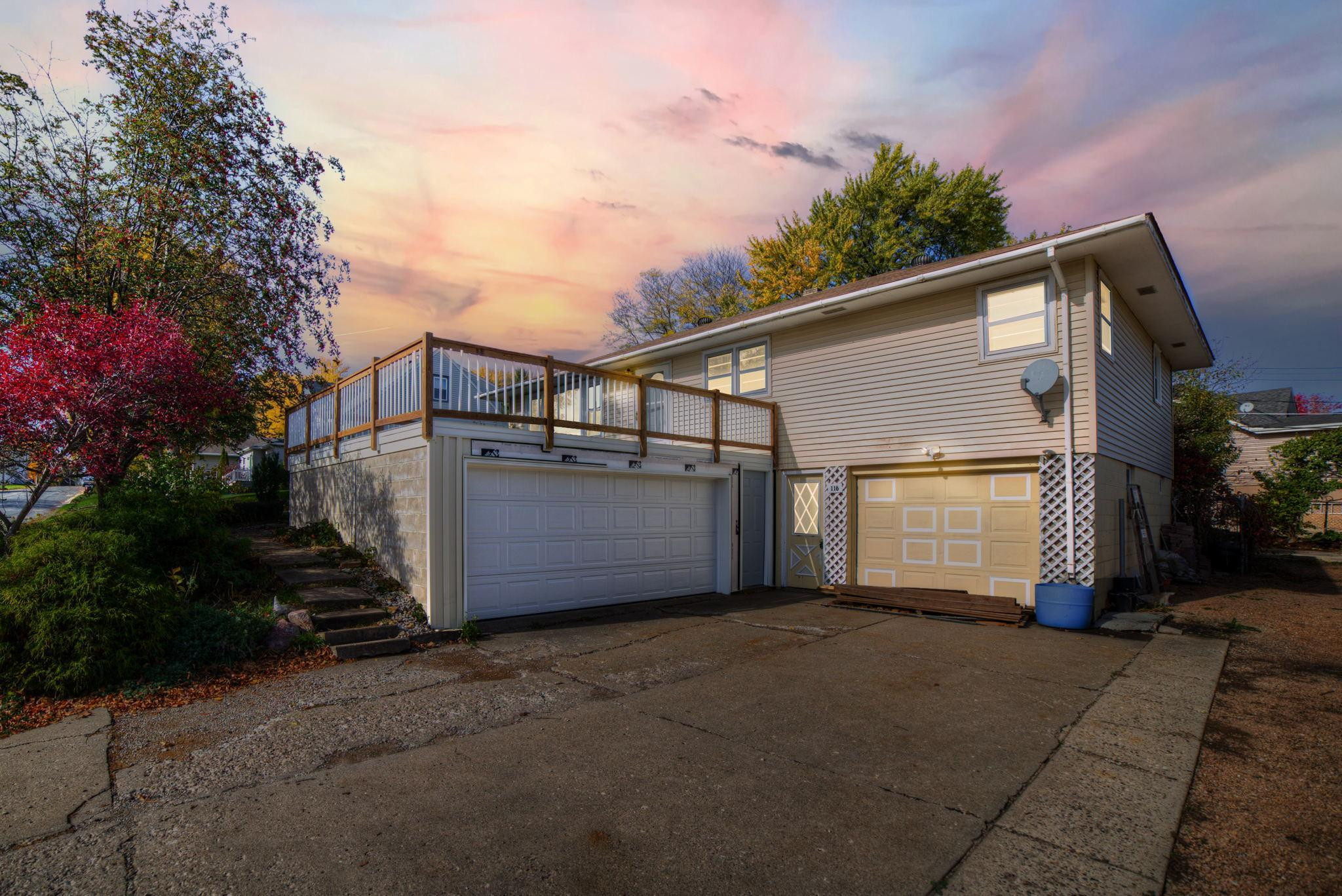 Wonderful 3 bed, 2 bath, 3 car garage home on a full blooming lot with gardens and a new, huge front deck!