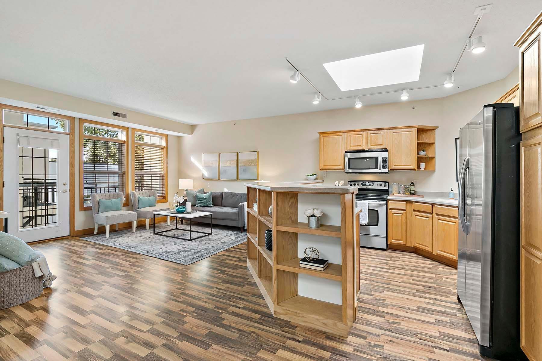 Light and bright top-floor condo is move-in ready and available immediately for a 12-month lease.