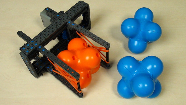 Image for VEX IQ Crossover. Task. Build an attachment for grabbing many hex balls