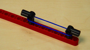 Image for Rubber bands - LEGO robot attachment triggered with a motor - part 2 removing the motor