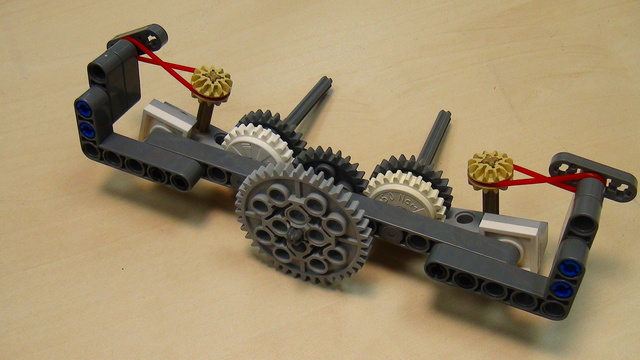 Image for Turning two axles, one at a time in opposite direction with one motor and two rubber bands