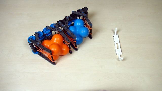 Image for VEX IQ Crossover. Task. Build the attachment with gear wheels for VEX Grabbing