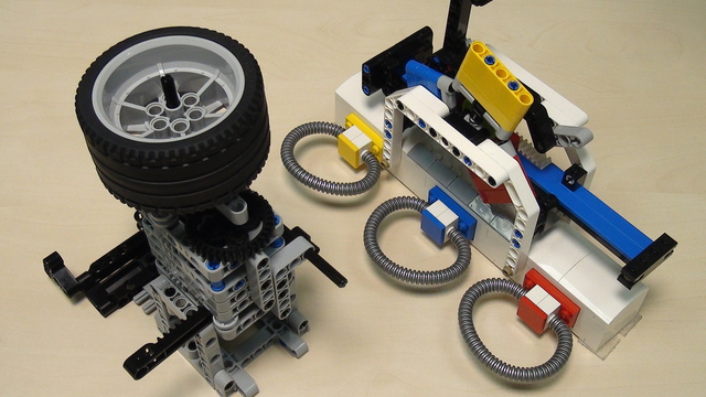 Image for Rubber band attachment with a flywheel - solving FLL 2014 Search Engine