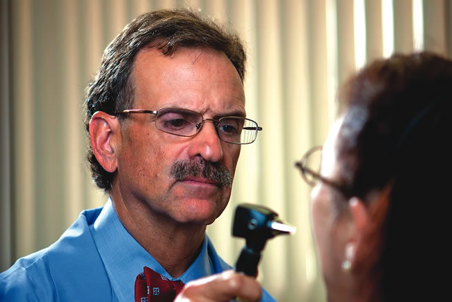 Dr. Mandel Sher