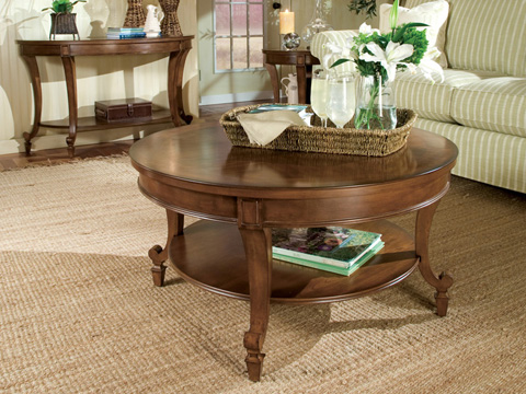 Image of Aidan Round Cocktail Table in Cinnamon Finish
