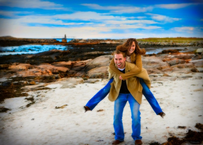 engaged couple at beach
