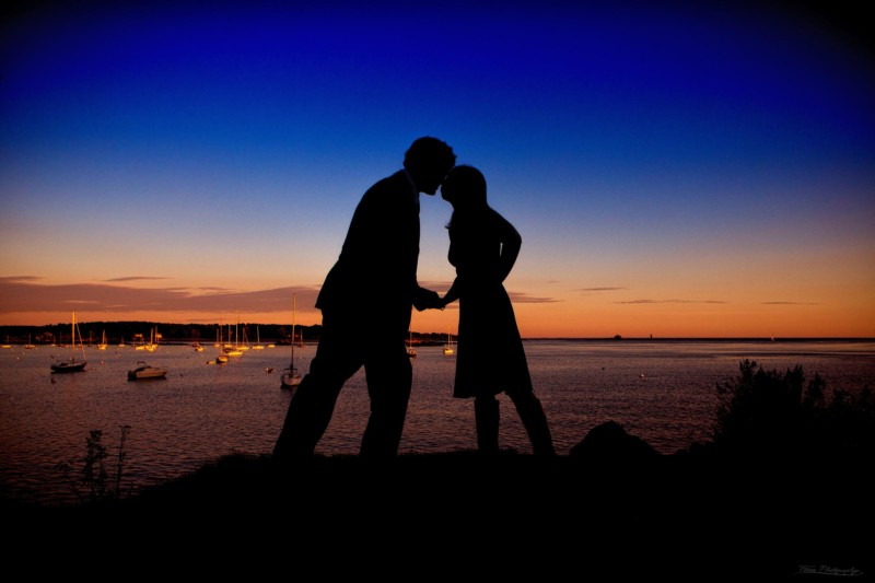 engaged couple at marina at sunset