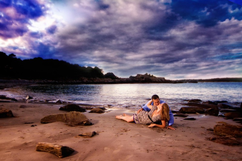 passionate engagement picture at beach in maine