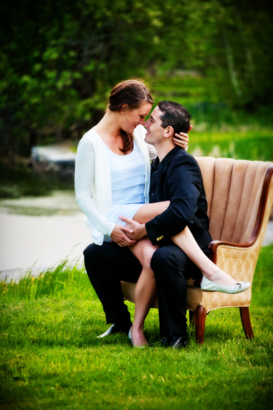 couple on chair for engagement session