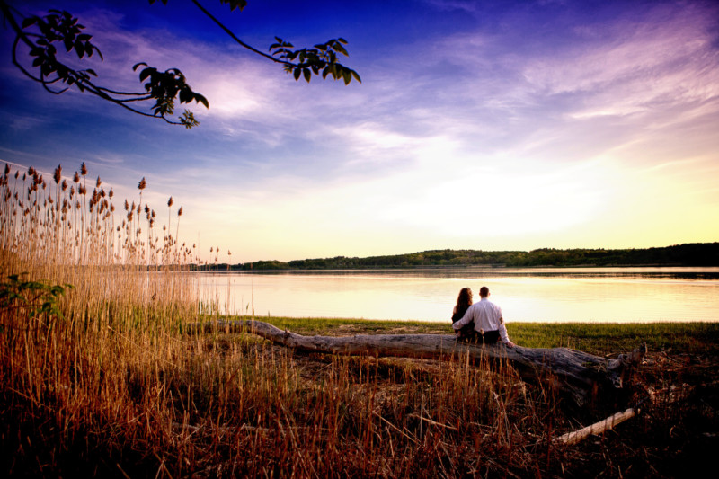 sunset over river at end of engagement photoshoot in maine