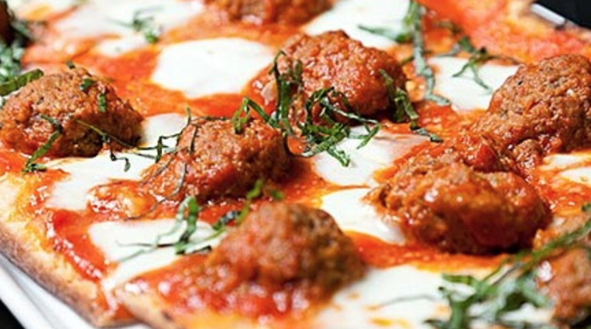 close-up of meatball pizza from Sip Wine Bar and Kitchen