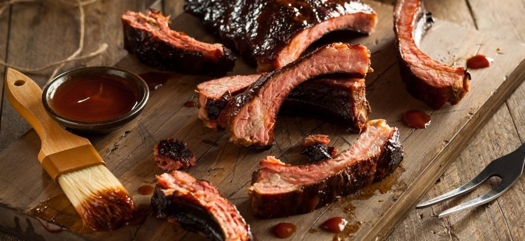 Shed's BBQ barbecue ribs with sauce on cutting board