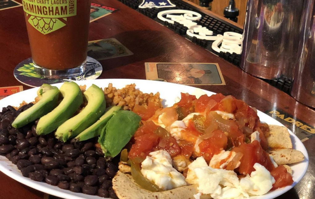 plate of Mexican food with rice, beans, and avocado from Coolidge Corner Clubhouse