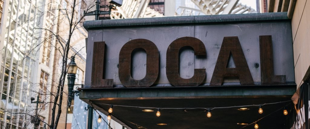 "large outdoor sign reading ""local"""