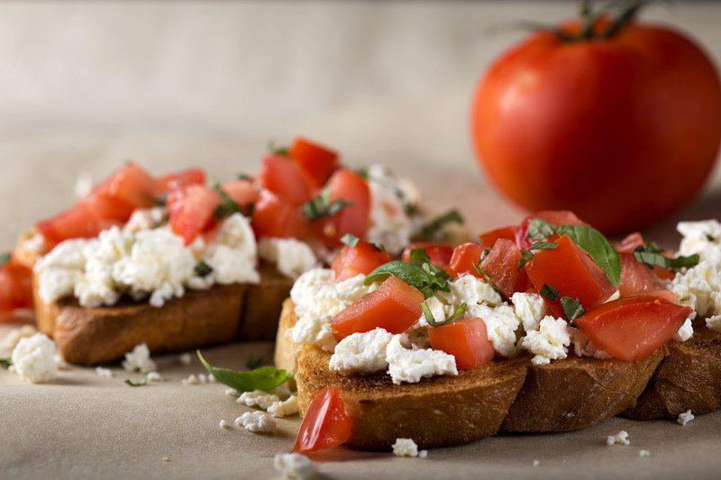 Bruschetta with tomato, cheese and herbs
