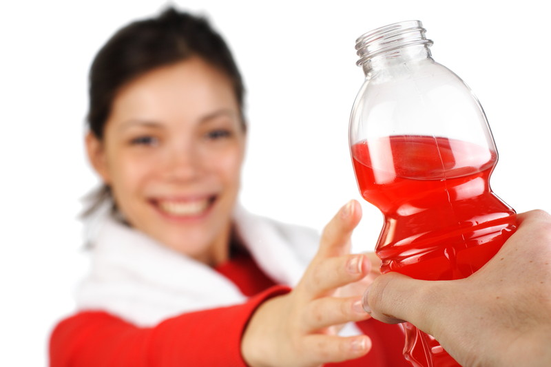Young woman being given a sports drink