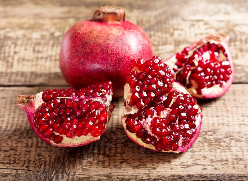 Pomegranate on wood