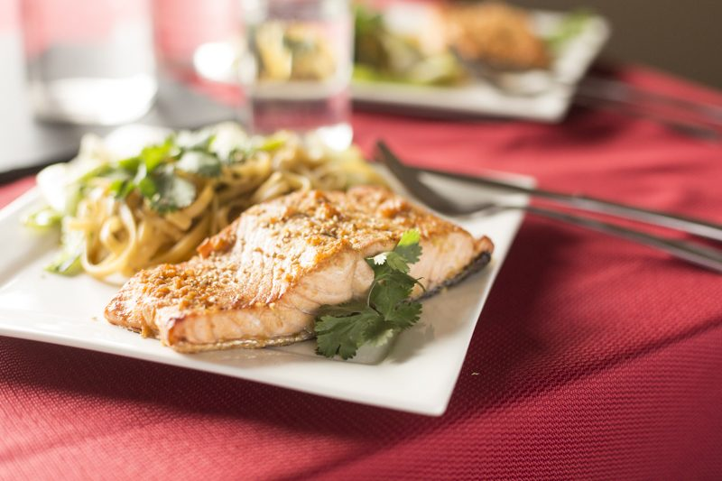 Crispy Asian Salmon Noodle Stir Fry Detail Shot Red Tablecloth Cilantro