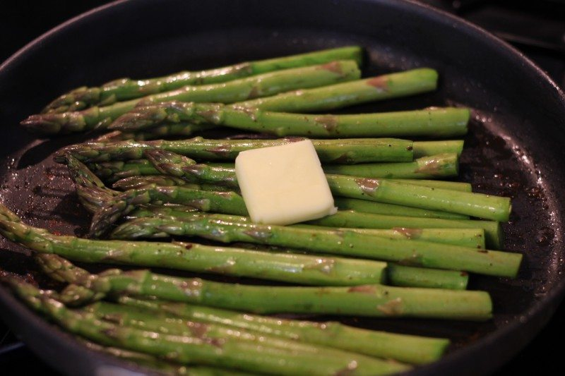 asparagus cooking with butter