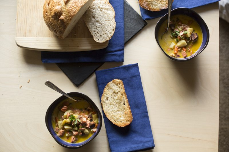Quick & Hearty Salmon Chowder Top Down Angled Two Settings Bread Loaf Blue
