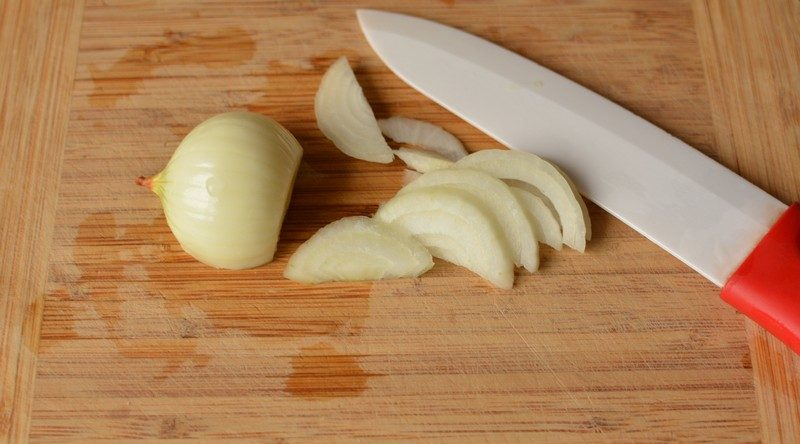 Chopping the onion for fried chicken liver