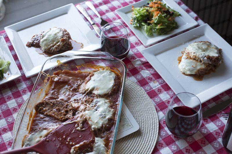 Eggplant Parmesan Dinner Dish Two Plates Square Plates Wine Glass
