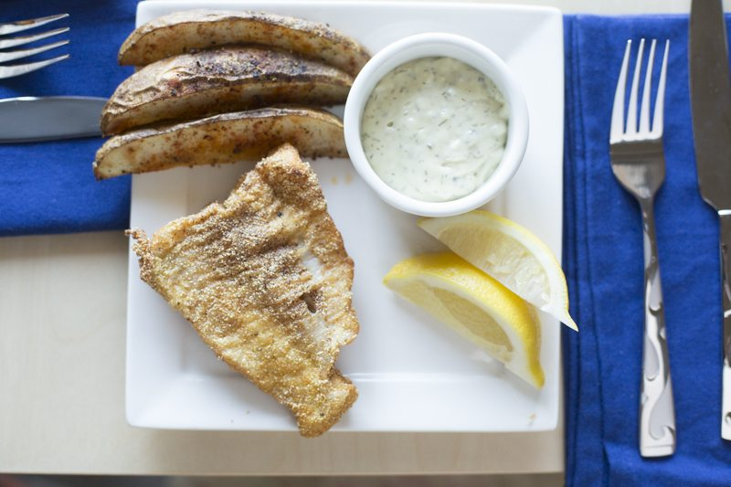 Fried Catfish Oven Fries Top Down Detail Cutlery Square Plate Lemon Tartar Sauce