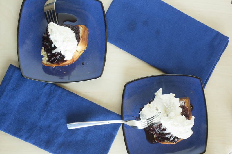 baba-rhum-rum-poached-cherries-chantilly-cream-top-down-blue-two-plates