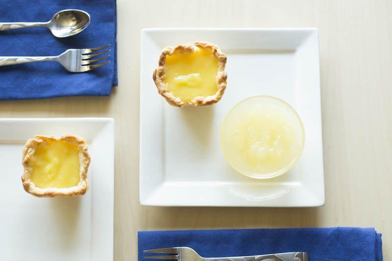 lemon-olive-oil-tart-basil-gin-granita-top-down-two-plates