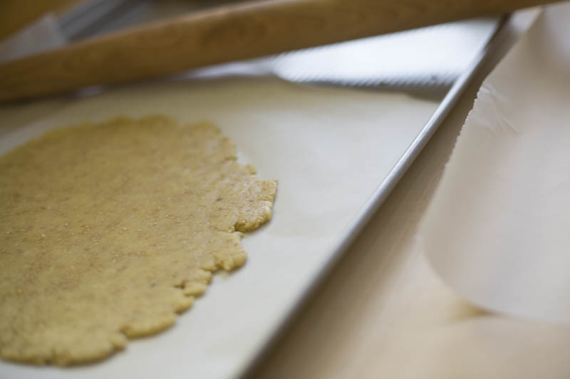 Using a rolling pin, divide the dough in two or three pieces
