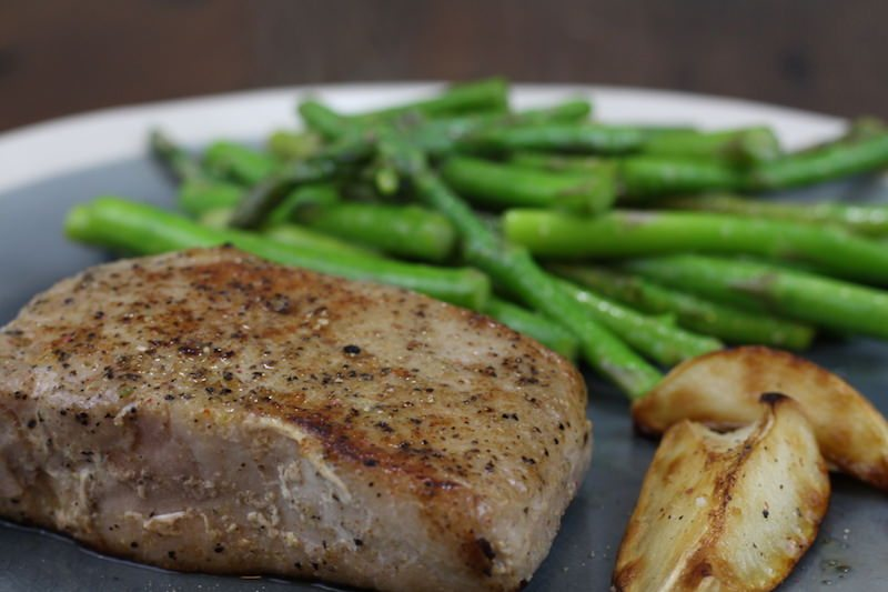 sous vide kings cut pork chops with elephant garlic and asparagus