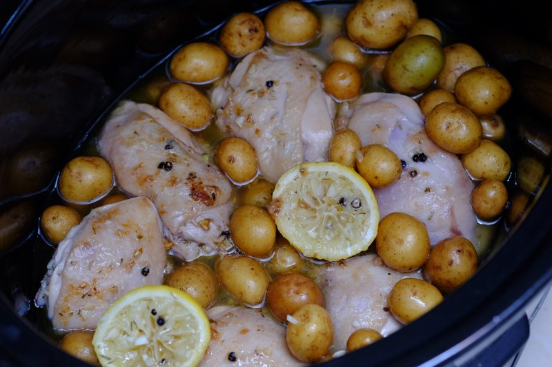 Get all the drippings and stock into the slow cooker together with the chicken and potatoes