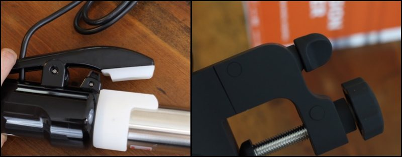 Lever clamp versus screw-down clamp. You can also see the heigh adjustment clamp