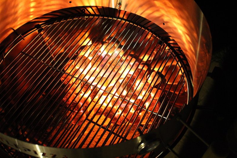 improper placement of grilling grates with kettlepizza (night photo with glowing coals)