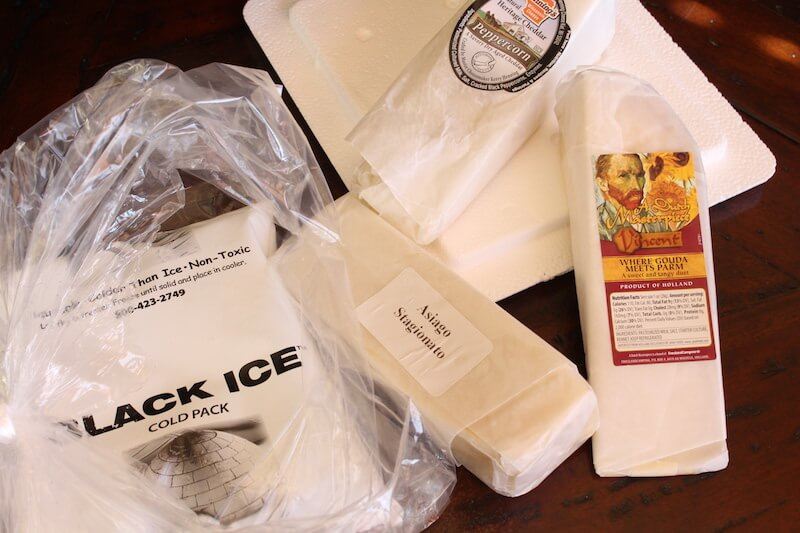 amazing clubs cheese of the month club review first package with ice pack and three types of cheese