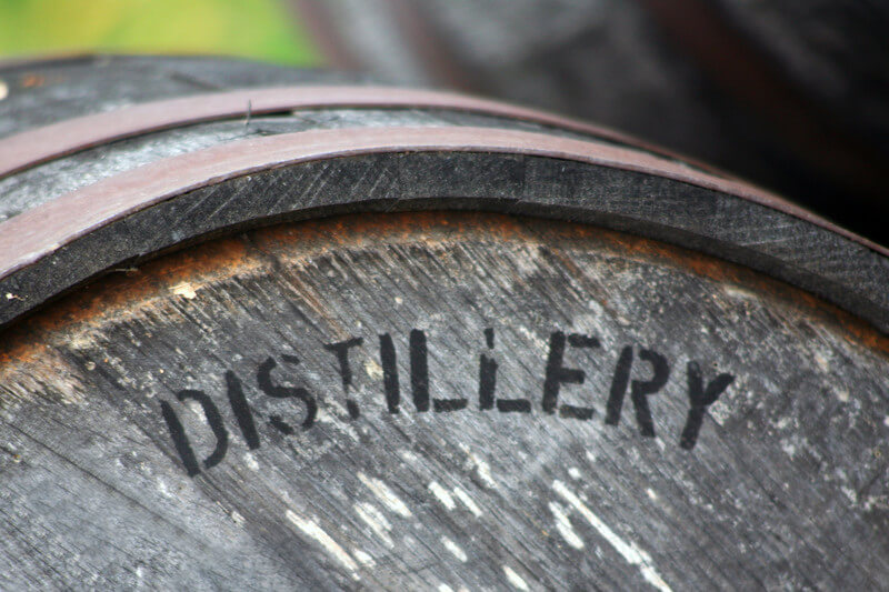picture of an old wooden barrel with the word distiller written on it