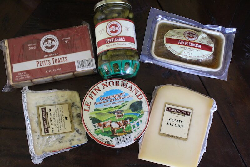 first box from di bruno bros. selections include pate, 3 types of cheese, pickles, and mini toasted crackers