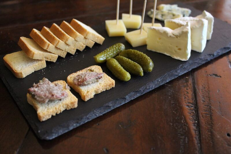 cheese, pick, and cracker snacks on slate cheese board