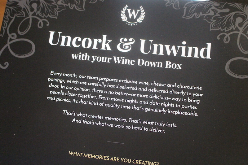 wine down box card insert describing what wine down box is about