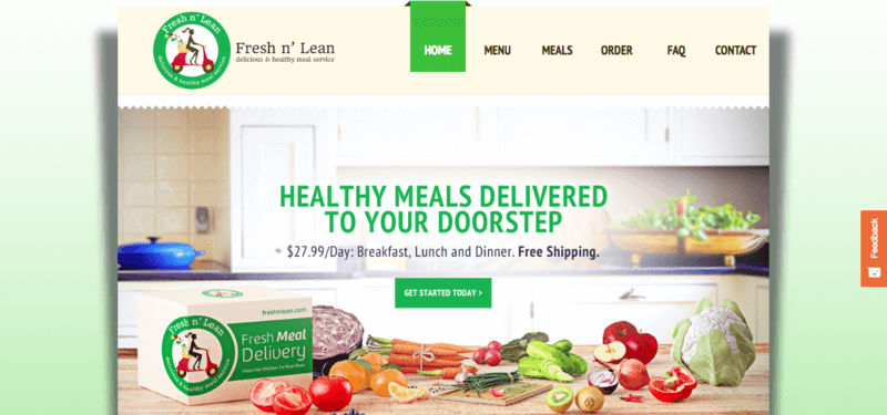 Fresh n' Lean website screenshot showing a kitchen with various fruits and vegetables on the counter, along with a Fresh n' Lean box