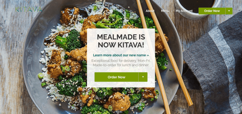 screenshot of kitava website, showing a prepared bowl that appears to include rice, chicken and broccoli on a wooden table