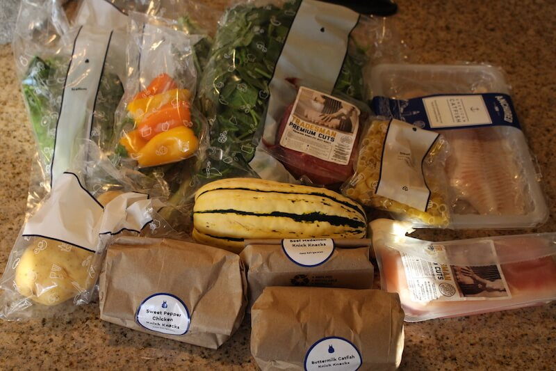 blue-apron-unboxed-with-groceries-on-counter