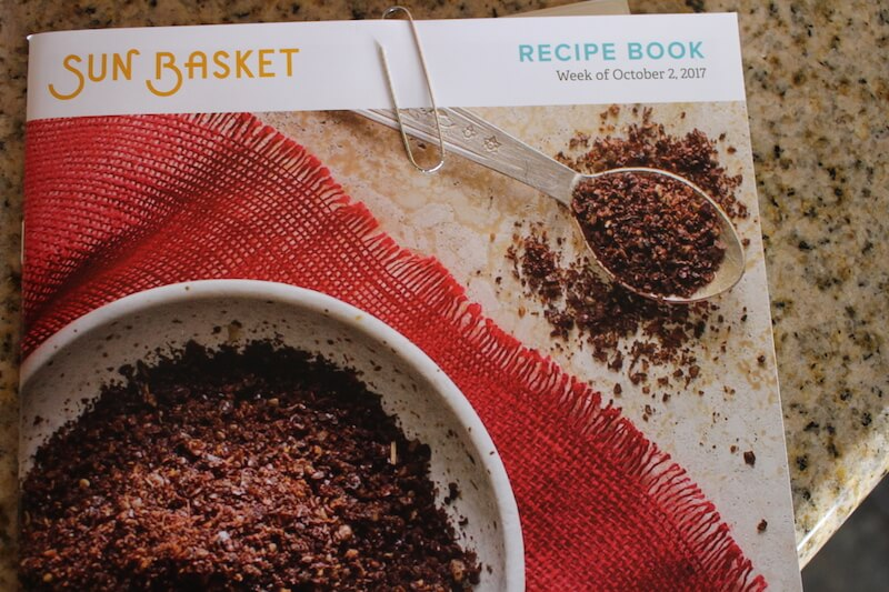 sunbasket recipe book featuring all recipes for the week, with a picture of spices on the front of book