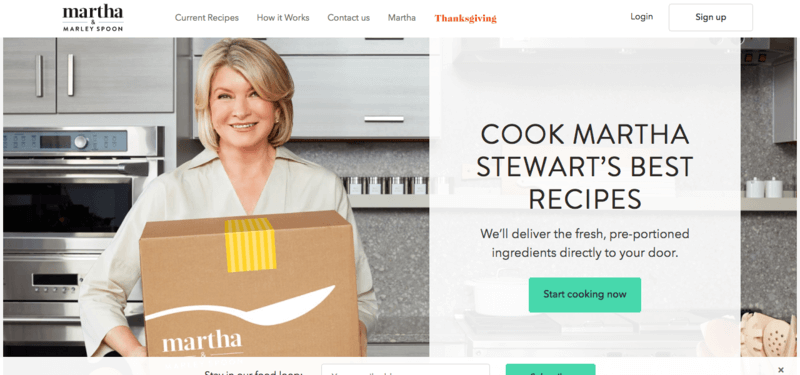 Screenshot from the Marley Spoon site showcasing Martha Stewart in a kitchen holding a box
