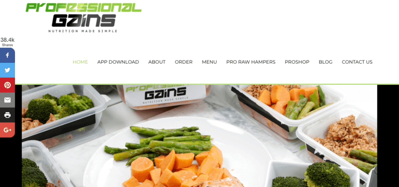 Professional Gains website screenshot showing a main meal of chicken carrots and asparagus, along with many other prepped meals