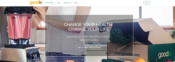 Goodie website screenshot showing a background image of a woman preparing a smoothie from a Goodie box.
