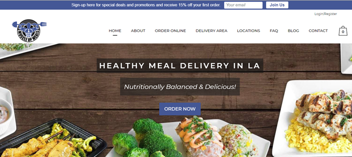 Muscle Up Meals website screenshot showing various meals on a dark wooden background.