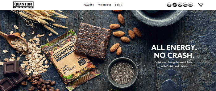 The website for Quantum Energy Squares shows an image of the Caffe Mocca Macciato Bar as well as a closed packet. There are also variou ingredients that go into the bar in the image, including oats, chocolate, almonds and coffee.