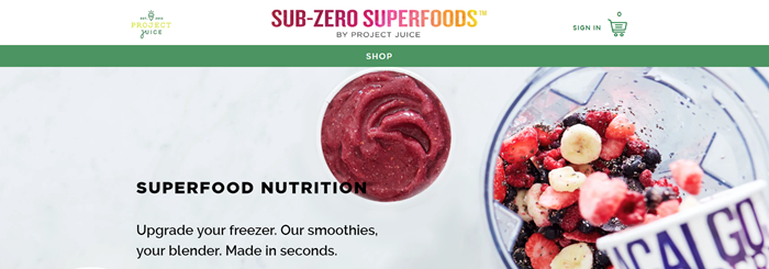 Sub-Zero Superfoods website screenshot showing a blender with frozen fruit and bananas, along with a prepared smoothie.