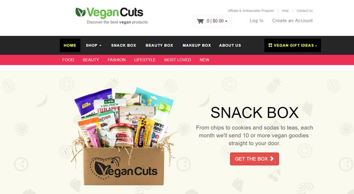 Vegan Cuts website screenshot showing a box from the company along with a range of snacks, against a light background with symbols of food.